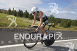 Andy Potts works the hills during the bike leg at…