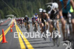 Age groupers work the hills during the bike leg at…