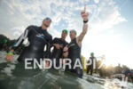 Age group athletes prepare for the swim at the Ironman…