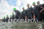 Age group athletes wait for the swim at the Ironman…