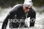A male pro completes the swim leg at the 2014…