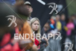 Spectators watch the swim exit at the 2014 Ironman 70.3…