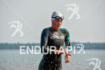 Eventual female champion Ariane Monticeli exits the water at the…