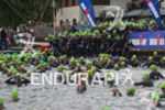 Age group athletes prepare for the swim start of the…
