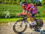Pro Paul Eicher cycling through the fields  at Ironman Wisconsin…