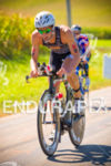 Brandon Marsh passes age groupers on the bike at the…
