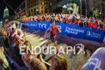 An athlete enjoys the raucous finish area at the 2014…
