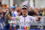 Matthias Knossalla at the finish of the Ironman 70.3 Ruegen…
