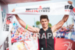 Matt Trautman wins at the 2014 Ironman Wales in Tenby,…