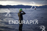 An athlete prepares for the swim start just prior to…