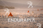 Swimmers engulf the buoys at the 2014 GoPro Ironman World…