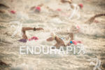 A female pro fights the crowding in the swim at…