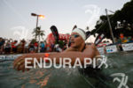 Jan Frodeno swims to the start of the swim portion…