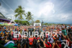 Crowd and media capture the finish of Sebastian Kienle at…