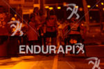 Paratriathlete at night in an aid station during the run…