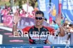 Craig Alexander crosses the finish line of the 2015 Ironman…