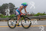 Mirinda Carfrae climbs the many hills on her bike at…