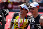Andreas Boecherer and Sebastian Kienle (l-r) at the finish of…