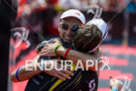 Andreas Boecherer hugs Sebastian Kienle at the finish of the…