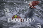 The pros battle choppy conditions during the swim at Escape…