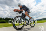 Michael Weiss competes in the bike leg during the 2015…