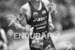Andy Potts battles the high heat during the run leg…