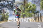 Heather Jackson beating back the heat during the run leg…