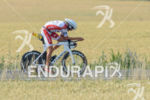 Jan Frodeno competes during the bike leg of the Ironman…