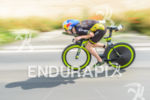 Sebastian Kienle competes during the bike leg of the Ironman…