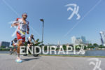 Jan Frodeno competes during the run leg of the Ironman…