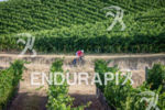 Sam Appleton bikes through the vineyards during the 2015 Ironman…