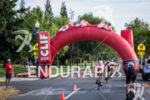Top pro men bike under the CLIF archway toward T2…