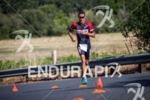 Craig Alexander chases first place male during the run at…
