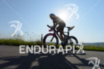 Horst Reichel competes during the bike leg of Challenge Roth…