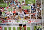 Nils Frommhold celebrates at the finish line of Challenge Roth…