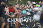 The pro men transition to the bike leg at the…