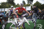 The pro women transition to the bike leg at the…