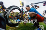 age group athlete prepares his bike before the 2015 Ironman…