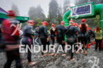 Athletes enter the water to start the swim at the…