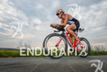 Camilla Pedersen competes during the bike leg of the Ironman…