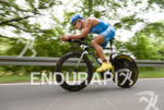 Andreas Dreitz competes during the bike leg of the Ironman…