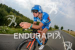 Andreas Raelert competes during the bike leg of the Ironman…