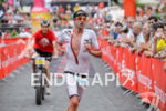 Boris Stein competes during the run leg of the Ironman…
