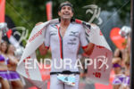 Boris Stein celebrates at the finish line of the Ironman…