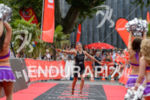 Anja Beranek celebrates at the finish line of the Ironman…