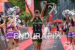 Alexandra Tondeur celebrates at the finish line of the Ironman…