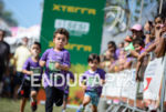 Child athlete during the run portion of the 2015 XTERRA…