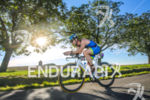 Age group athlete(s) during the bike leg of the inaugural…