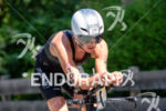 Anja Beranek competes during the bike leg of the 2015…