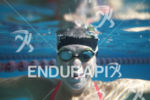 Lauren Goss poses underwater during a pre-race pool workout in…